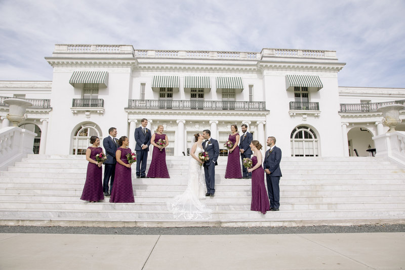 bridal party in front of  monmouth university library