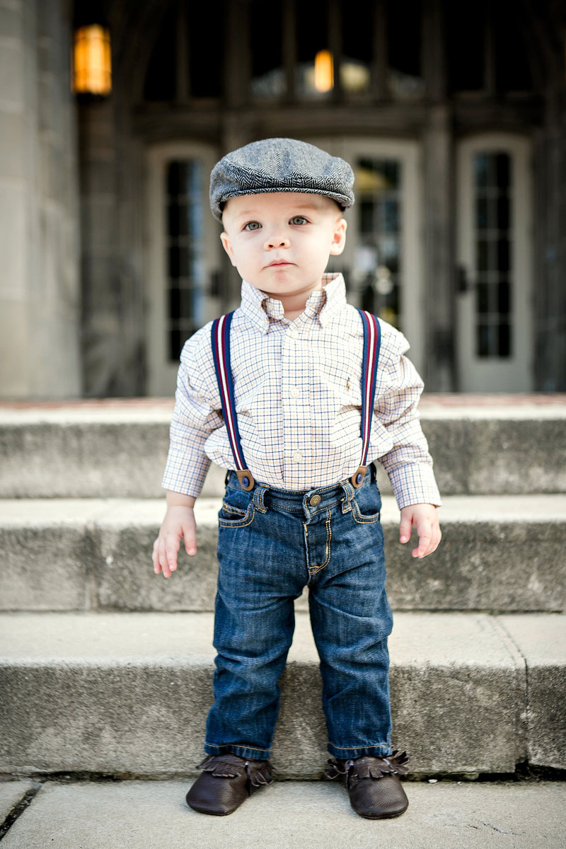 Toddler in suspenders and a paperboy hat on UT Campus by Knoxville Wedding Photographer, Amanda May Photos