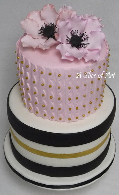 pink anemone cake with gold and black stripes
