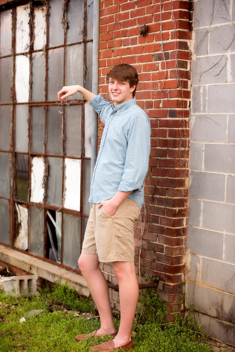 High school senior guy poses for portrait photographer