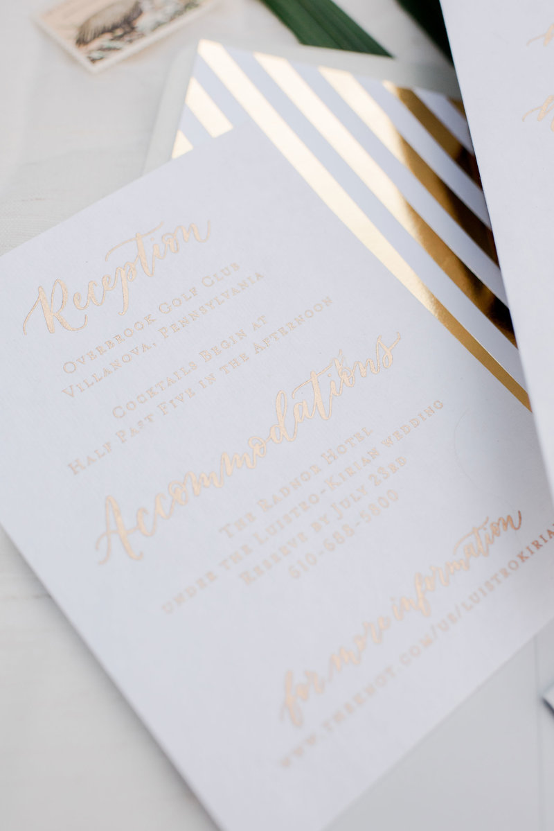 Gold ink on white paper custom calligraphy by Lewes Lettering Co