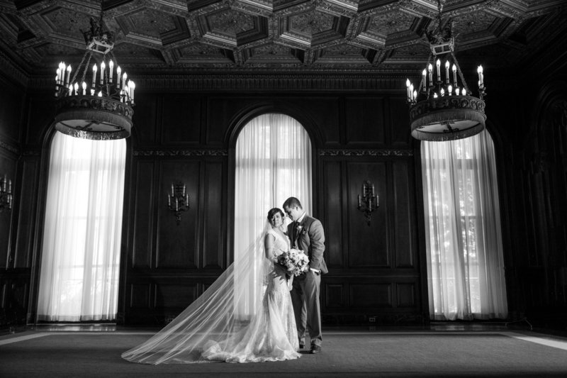 black and white bride and groom in grand ballroom