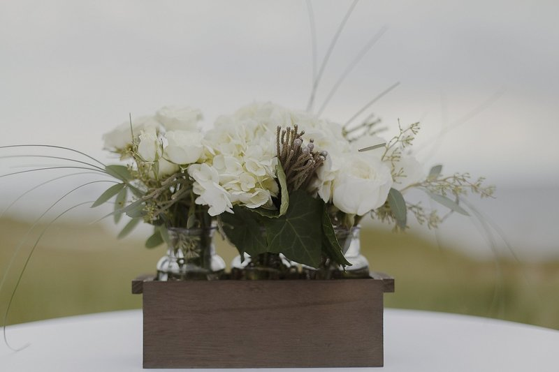 White Floral Centerpieces on the beach