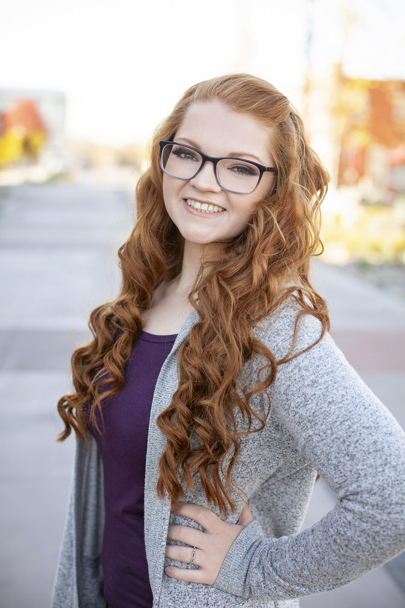 outdoor headshot of red hair girl in downtown caldwell