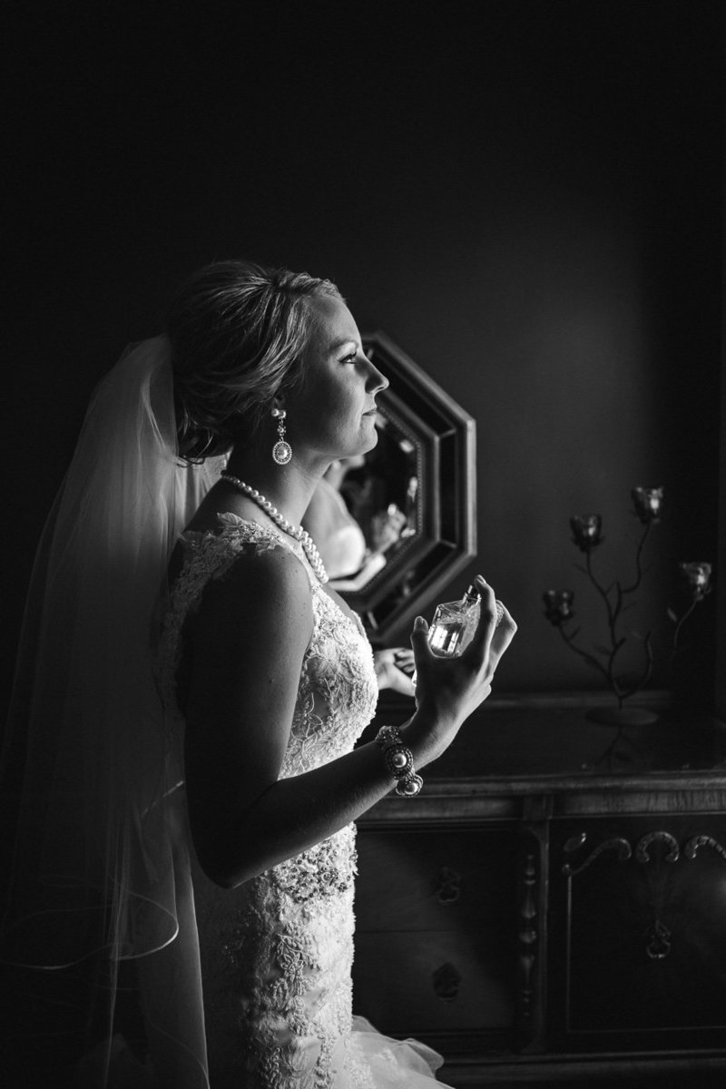 Bride spraying herself with perfume at Talon Winery Wedding Venue by Knoxville Wedding Photographer, Amanda May Photos.