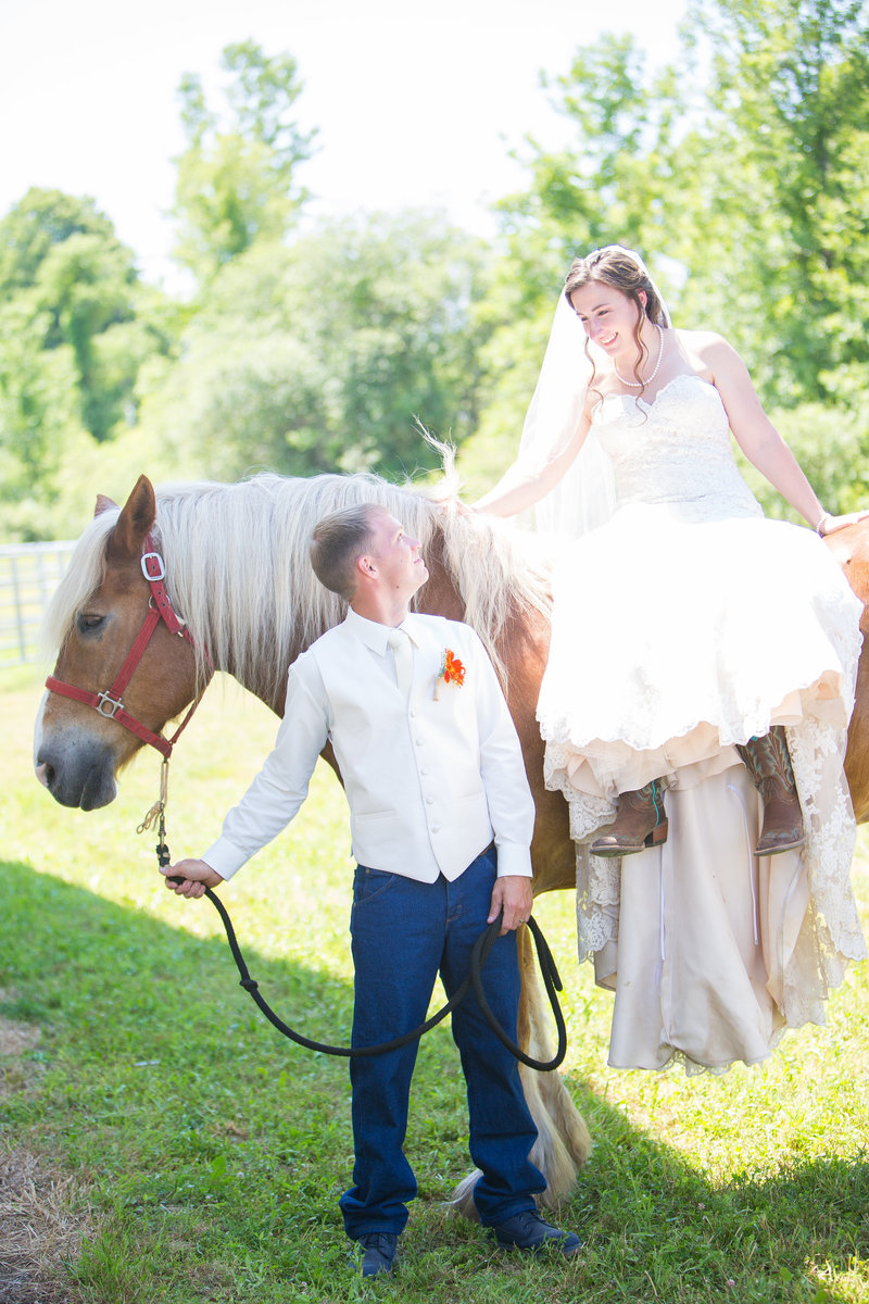 54 wedding photography Groom with Bride on Horse