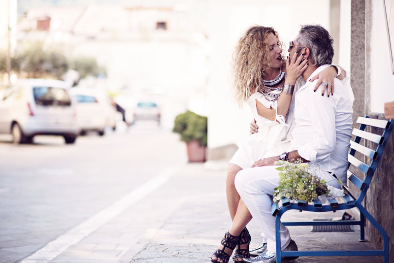 Italian couple relax and kiss on the streets of Santa Maria