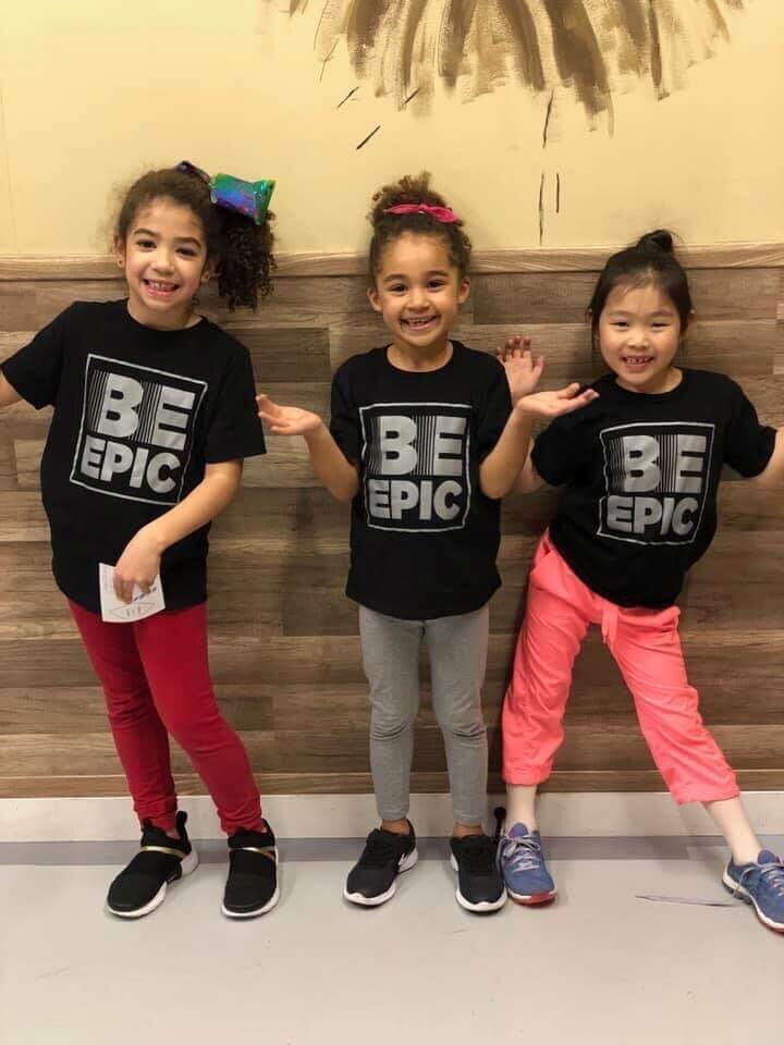 Cute performers with Be Epic shirts on