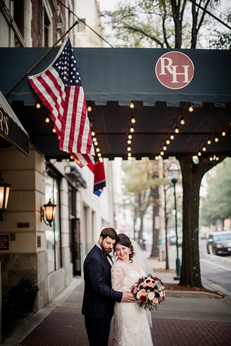 Wedding couple under the awning at the Read House Wedding Venue by Knoxville Wedding Photographer, Amanda May Photos.