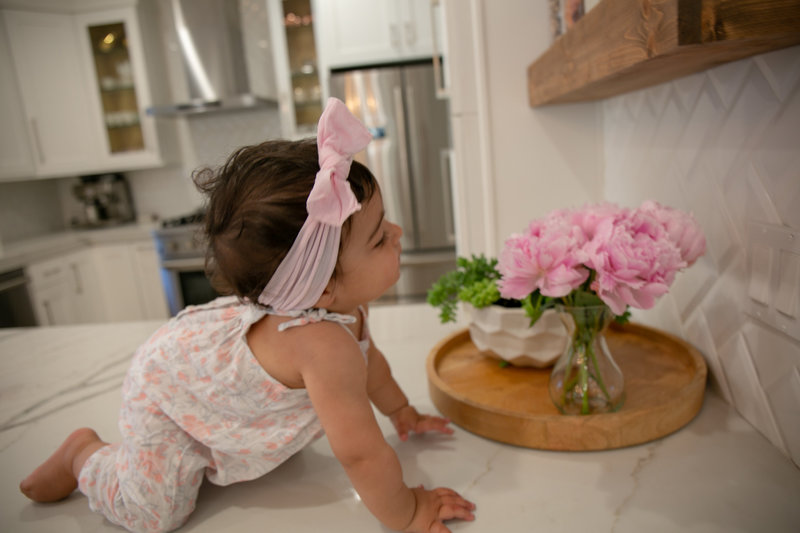 baby and peonies