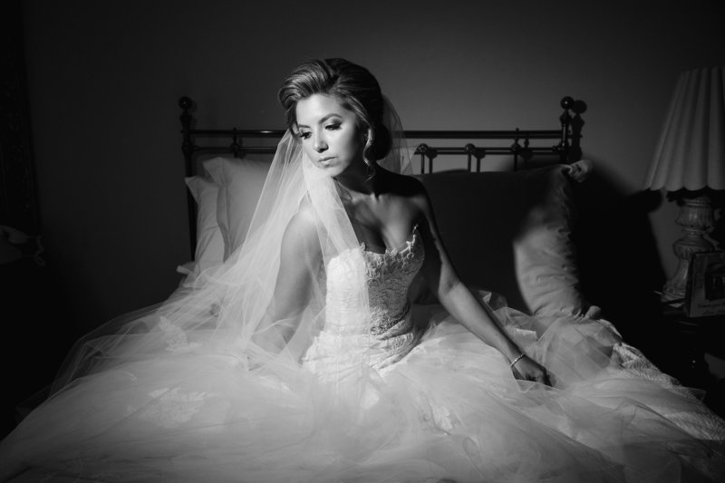 black and white glamour bride sitting on bed
