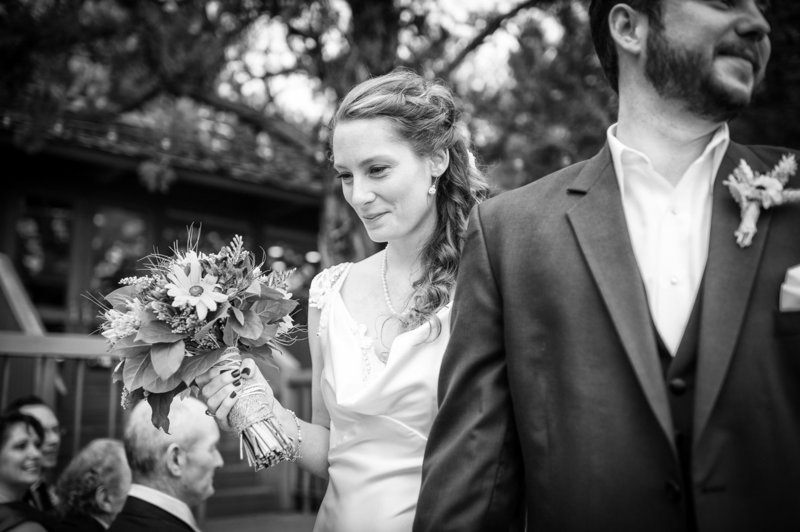 A happy moment at the end of the ceremony for a couple during their destination wedding at Eagle Crest Resort. Pete Erickson Photography.
