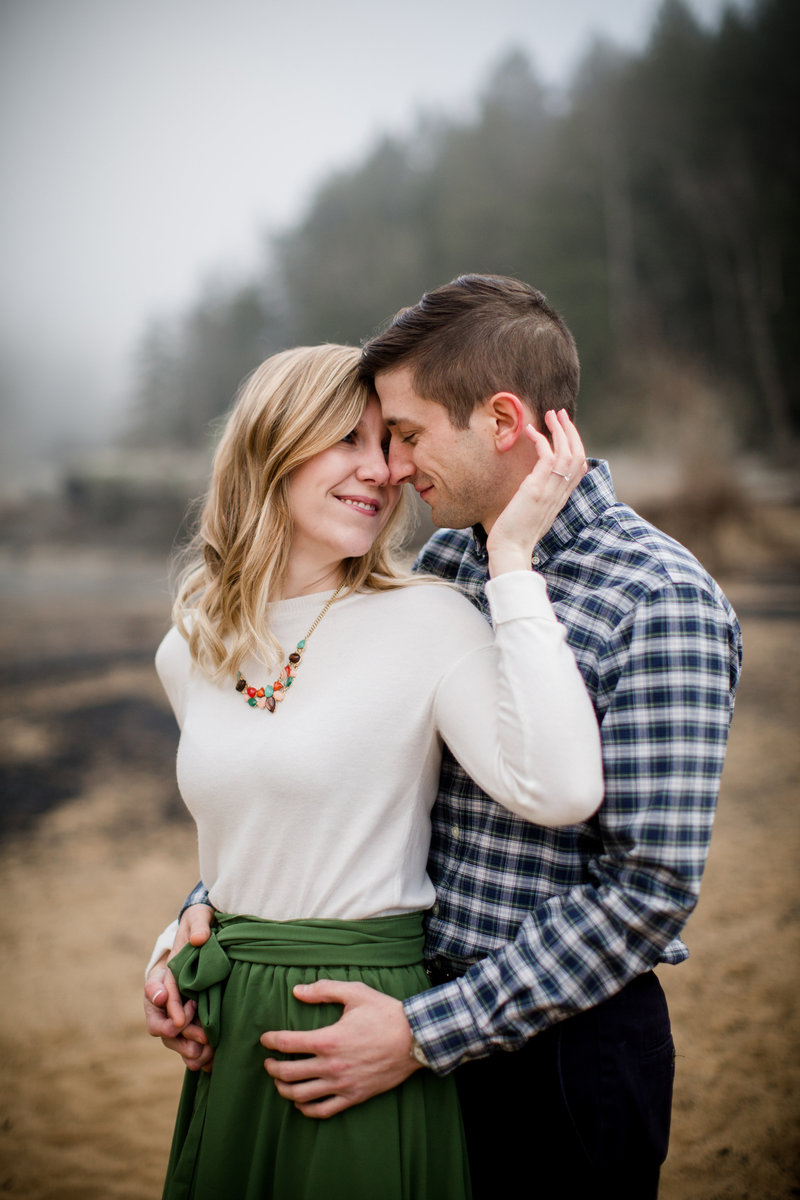 Cuddled up on the wintery beach of Cumberland Falls by Knoxville Wedding Photographer, Amanda May Photos.