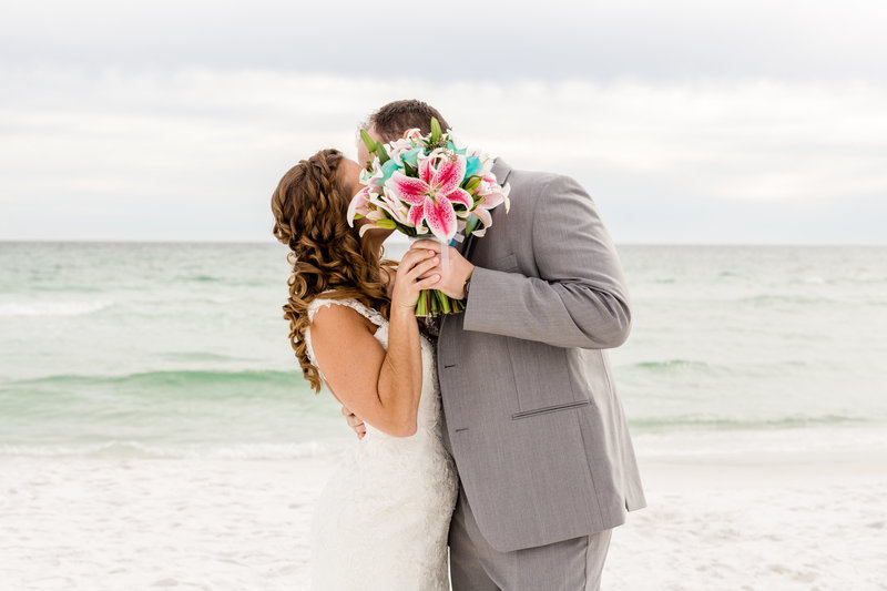 Bridal portrait on the beach with a yellow flower bouquet