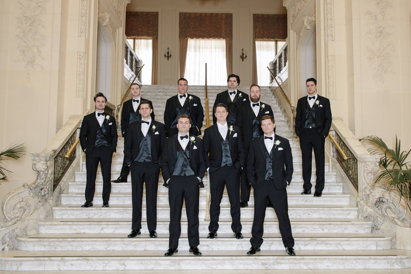 groomsmen standing on grand staircase at monmouth university
