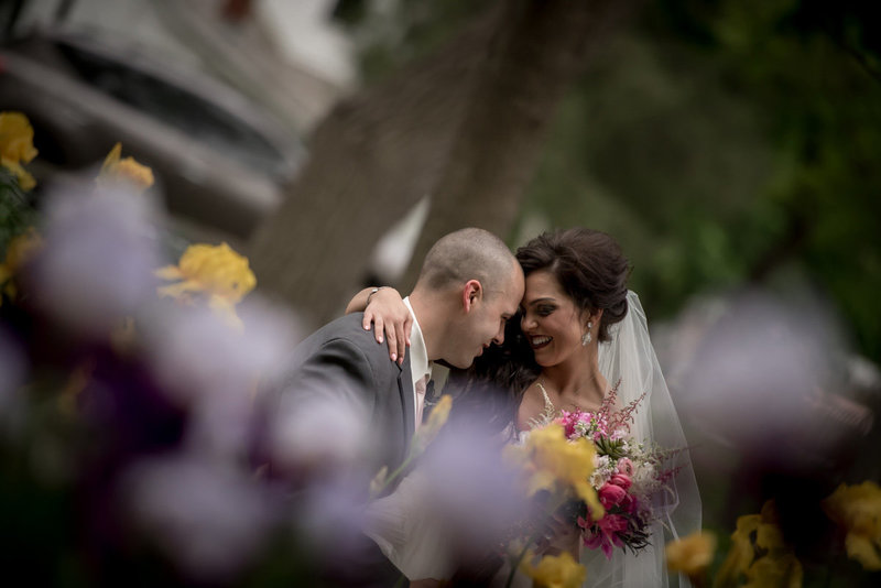 bride-groom-through-flowers