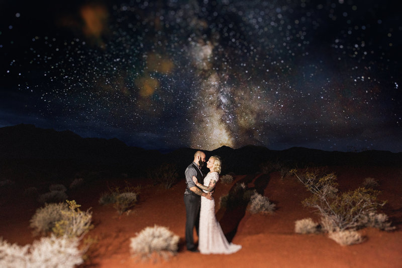 couple kisses under stars at valley of fire