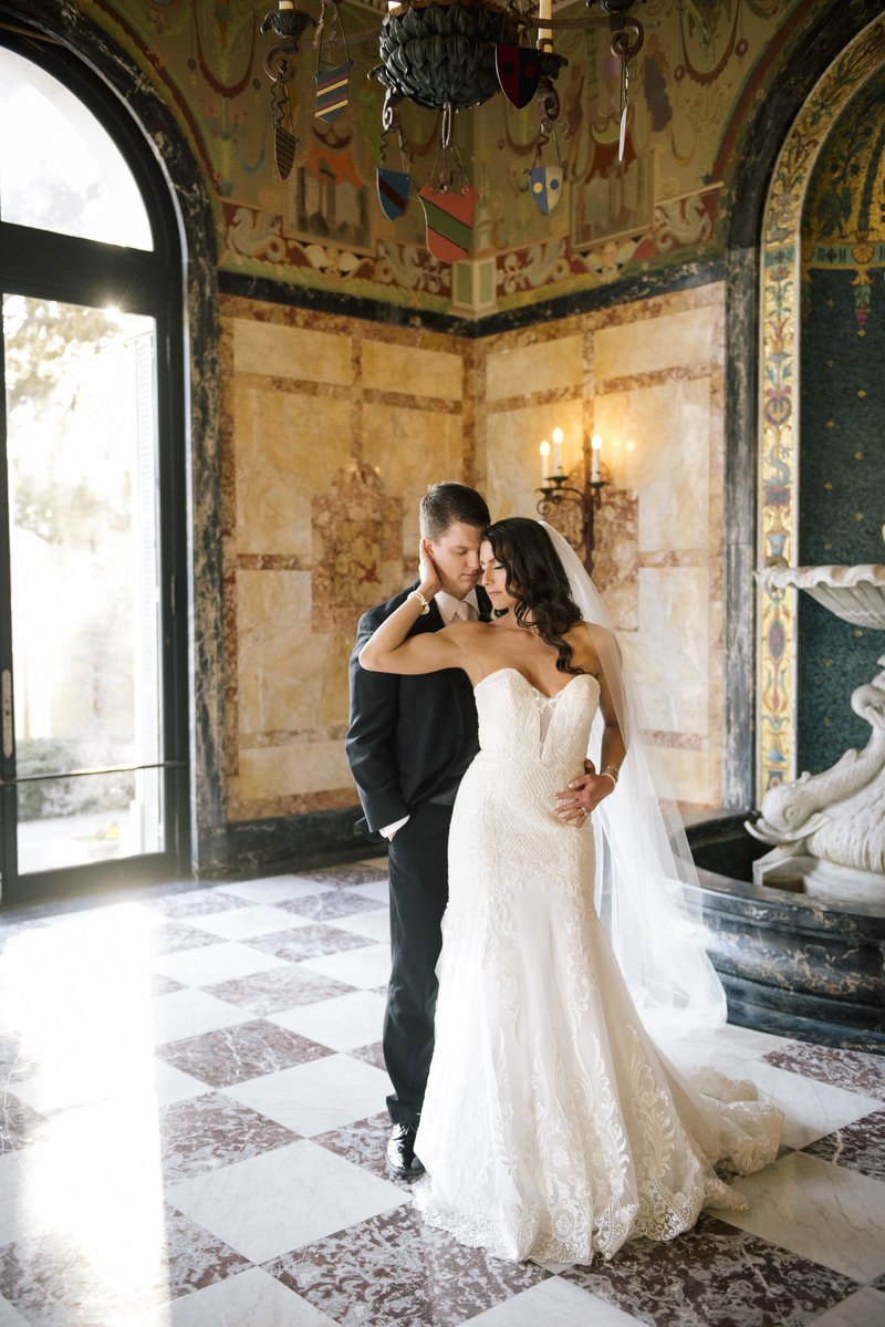 groom holds bride at in hall at monmouth university