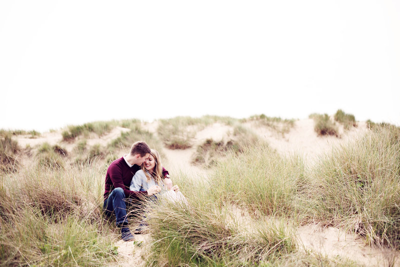 A couple hug in the sand dunes on Formby Beach