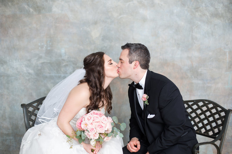 Roswell bride and groom lean in for a kiss