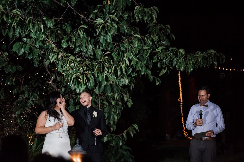 the newlyweds are in stitches over a funny wedding moment