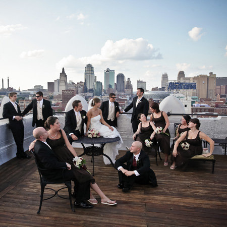Couple loves their wedding photographer writes great and simple review. Wedding bridal party hangs out on the roof of the WesterAuto lofts before going to the Kansas City reception at 1000 Grand