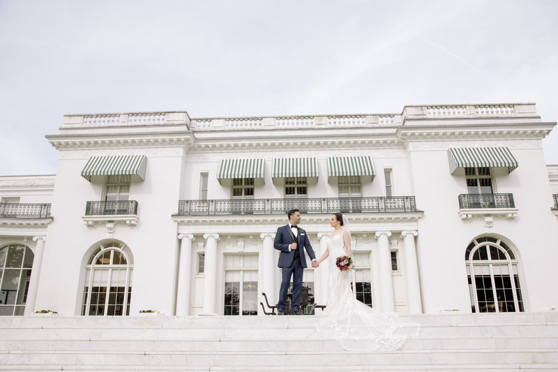 bride and groom in front of Monmouth university library