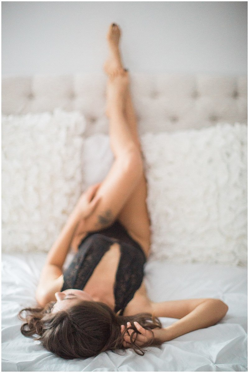 asian woman boudoir legs up on edge of bed