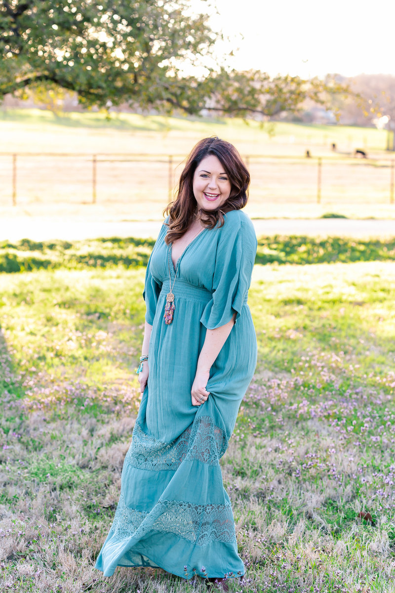 Jill of Jill Blue Photography in Turquoise dress from Versona in a field
