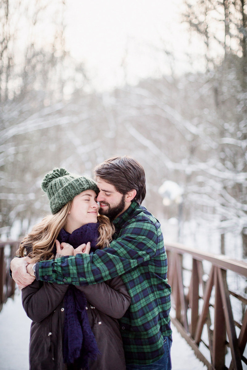 Young couple plays in the snow in the Smoky Mountains by Knoxville Wedding Photographer, Amanda May Photos.