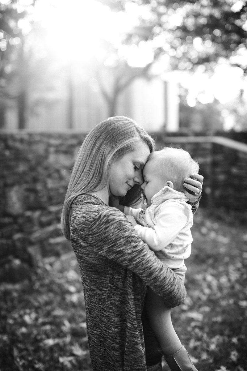 Mom forehead to forehead with her little girl at Knoxville Botanical Gardens by Knoxville Wedding Photographer, Amanda May Photos.