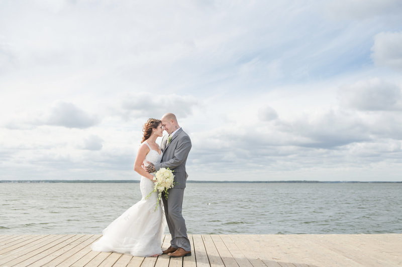 fall lavallette gazebo wedding with bride and groom posed on the bayfront