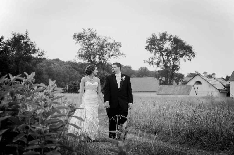 Bride and groom walk by farm, Brandywine Creek State Park, Wilmington, Delaware