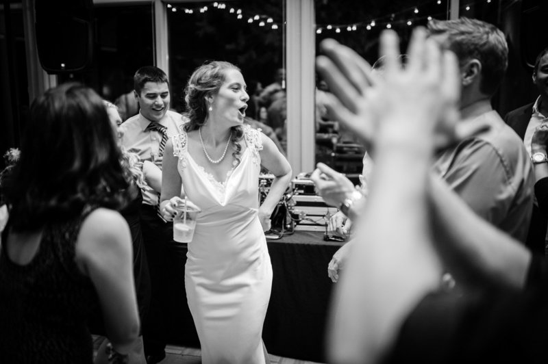 The bride dances during the reception at her destination wedding at Eagle Crest Resort. Pete Erickson Photography.