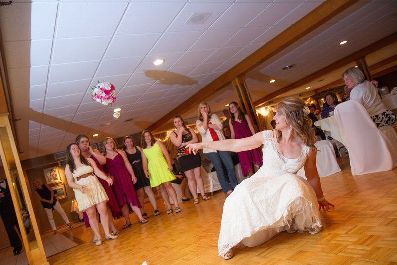 wedding photography reception bouquet toss-2-81