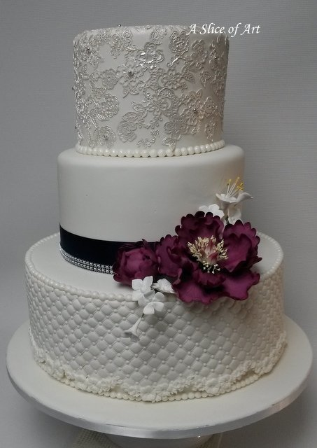 weddingcake with pearls and cake lace. sugar peony