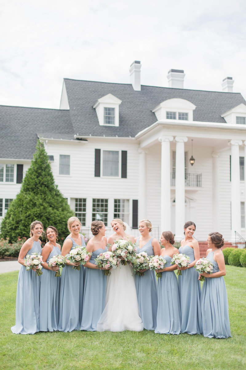 bridesmaids in front of kirkland manor on wedding day