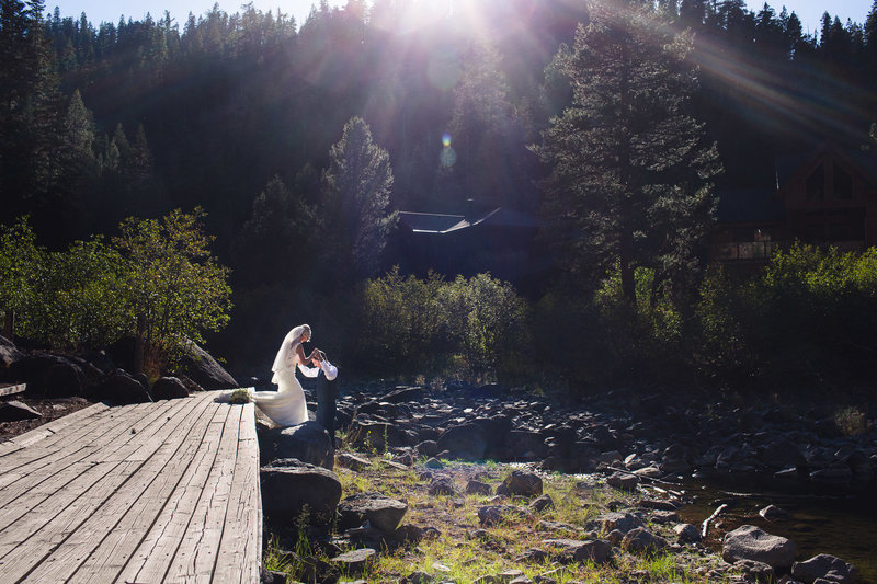 alice-che-photography-lake-tahoe-wedding-gorgeous-mountains-groom-helping-bride