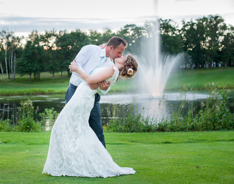 Thumper Pond at sunset with the pond fountain make a romantic setting for photos! Kris Kandel Fargo photographers www.kriskandel.com