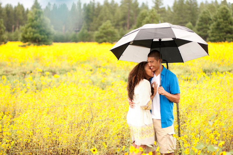 sunflower field engagement session, rain engagement session