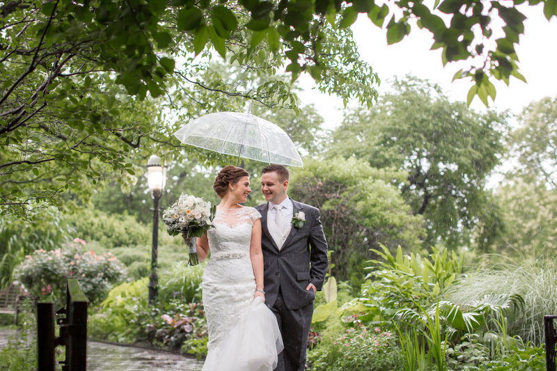 Romantic bride and groom at rainy day wedding