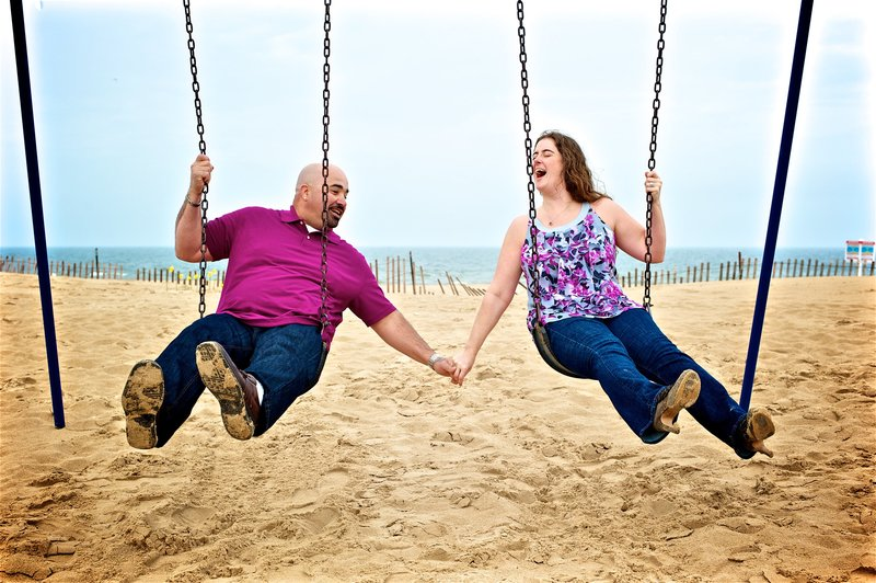 Engagement Portraits on the swings at Silver Beach in St. Joseph Michigan