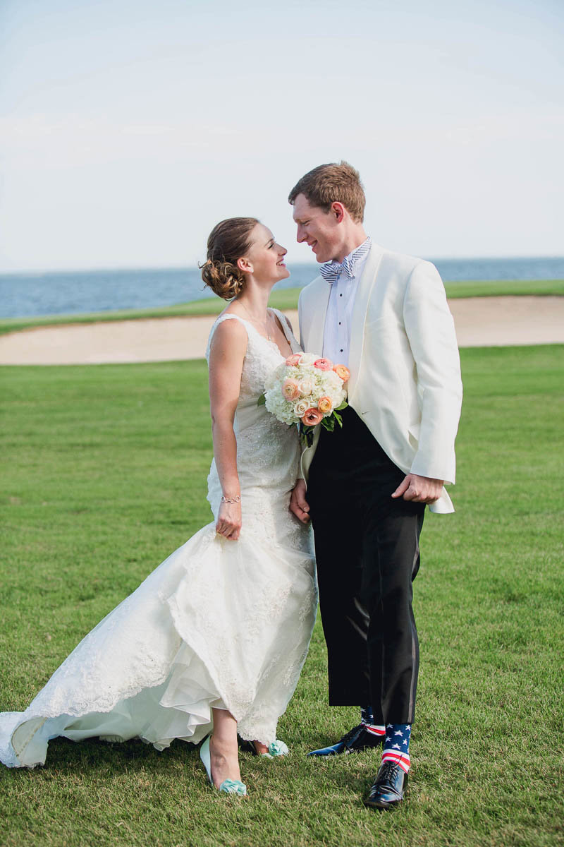 Bride and groom pose together on golf course, Rehoboth Beach Country Club, Delaware