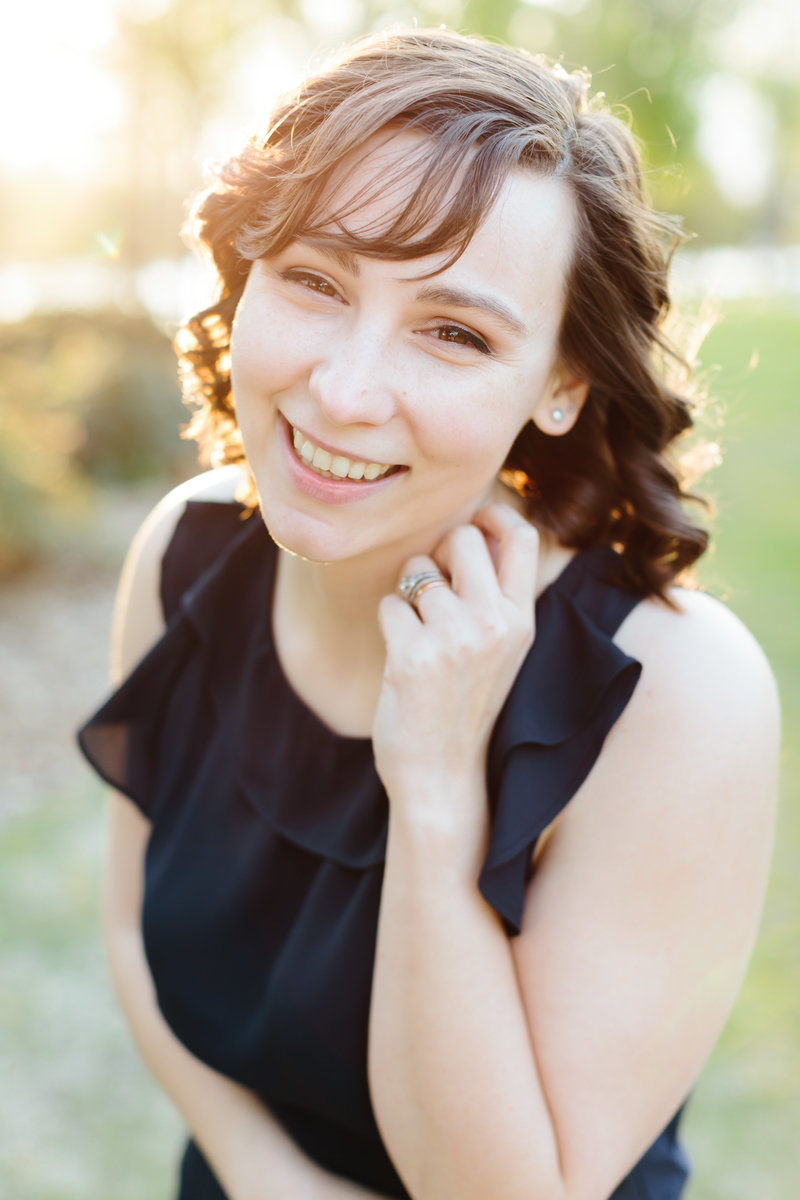 a bright and airy photograph of a female wedding photographer in mebane NC