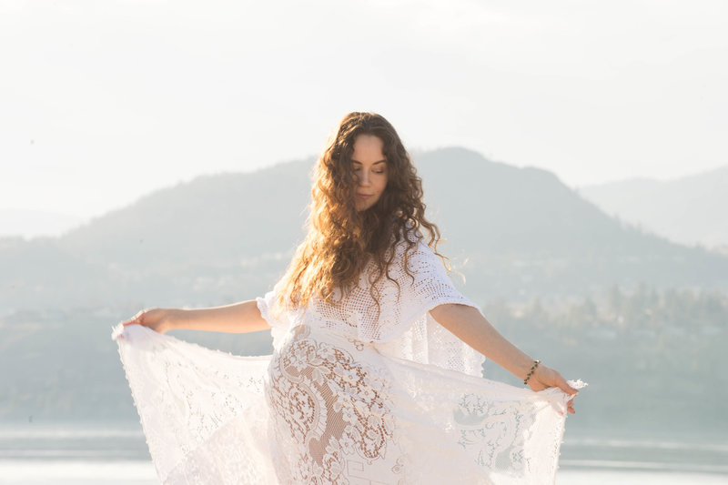 Boho chic Maternity photos in the summer on the lake backlit by the sun  in Kelowna . Dress by Reclamation