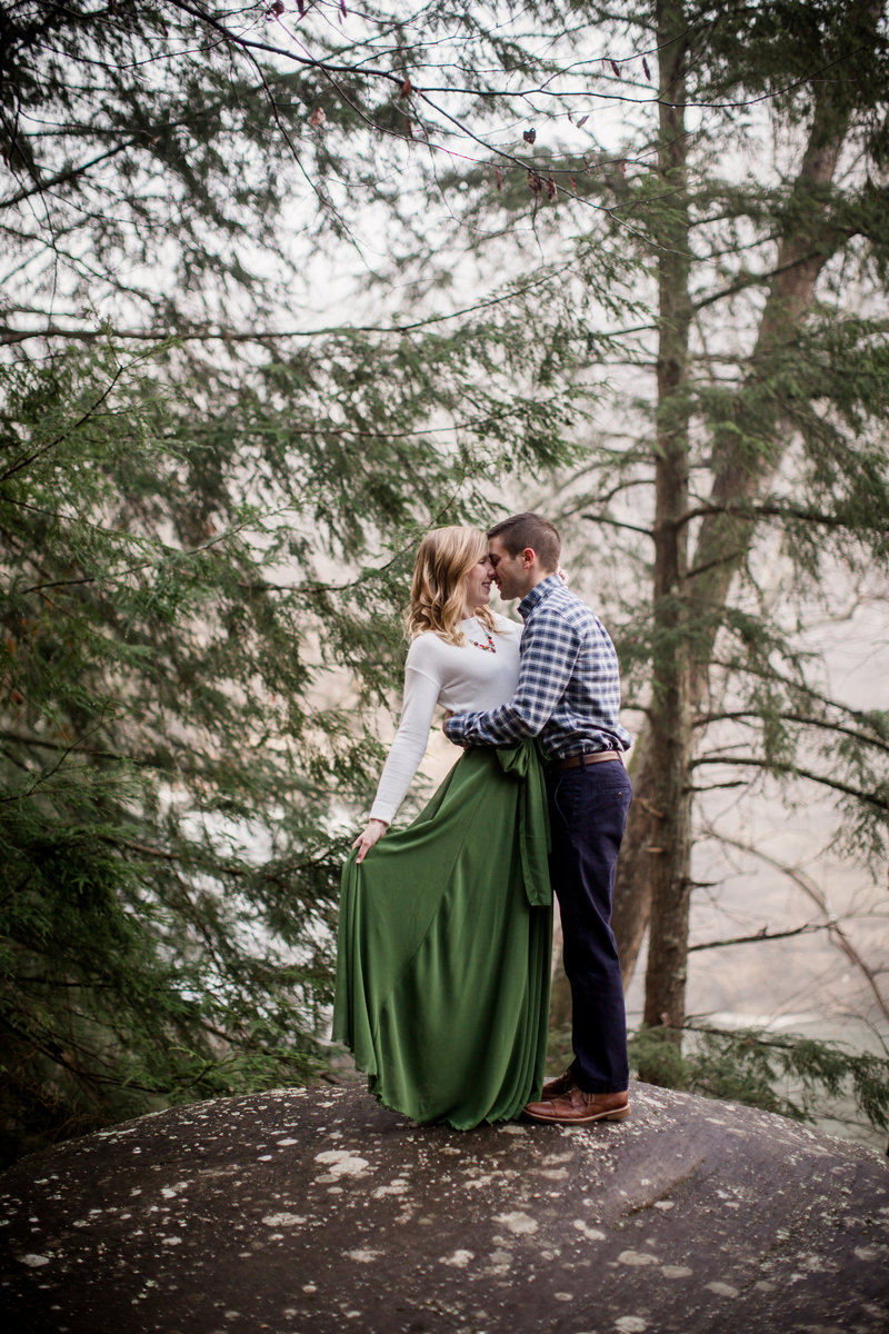 Standing on a rock at Cumberland Falls by Knoxville Wedding Photographer, Amanda May Photos.