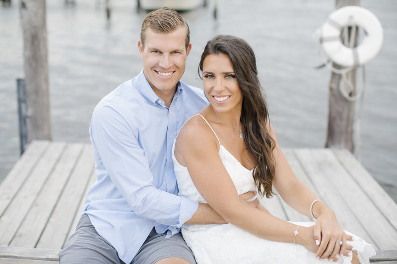 portrait of couple on dock in summer