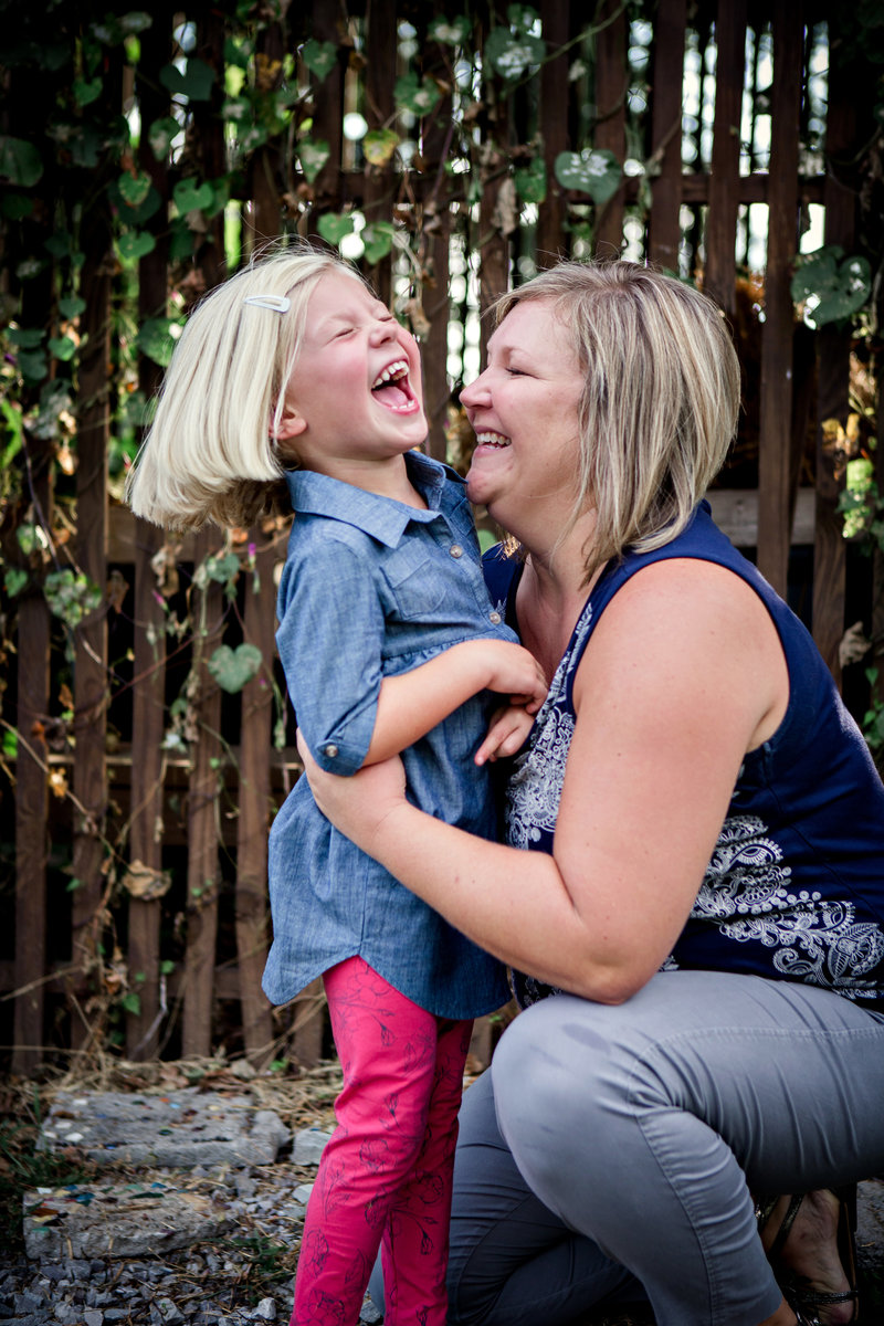 Mom playing with her little daughter at Tates Elementary School by Knoxville Wedding Photographer, Amanda May Photos.