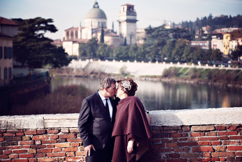 Bride and Groom of The Italian Wedding Planner on the bridge in Verona
