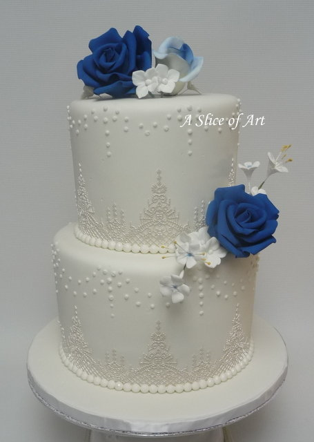 wedding cake with cake lace and royal icing dots sugar roses